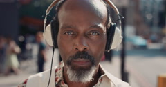 Slow Motion Portrait of happy mature african american man listening to music - stock footage