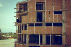brick wall of building construction site, image used old vintage style filter - stock photo