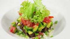Salad with veal, tomatoes and avocado (loop) - stock footage