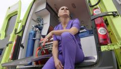 Emergency medical ambulance service stressed paramedic working 24-hour shift Stock Footage