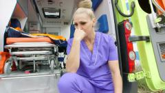 Emergency medical service stressed paramedic blaming himself for loss a patient Stock Footage