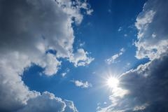 Clear weather sky, sun on blue sky with clouds, sun rays Stock Photos