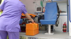 Emergency medical technician working at the site of illness or injury Stock Footage