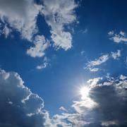 Clear weather sky, sun on blue sky with clouds, sun rays Stock Photos