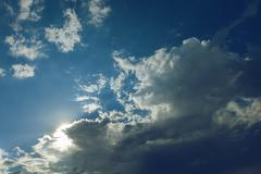 clear weather sky, sun on blue sky with clouds, sun rays - stock photo