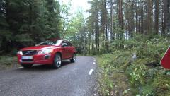 Volvo drives in sweden nature - stock footage
