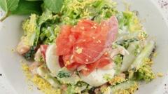 Salmon salad with prawns, closeup Stock Footage