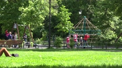 Kids play in playground with rope swing carousel . 4K Stock Footage