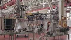Space rocket engine factory hall - pan right Stock Footage