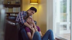 4K Attractive young gay couple relaxing at home and chatting Stock Footage