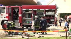 Stock Video Footage of firemen ammunition demonstration show in green park. 4K