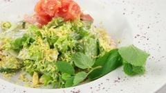 Salmon salad with prawns - stock footage