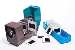 Vintage filmstrip projector on the white background. Stock Photos
