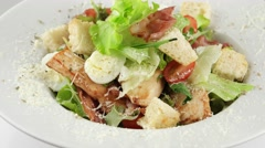 Caesar salad with chicken and quail eggs (loop) - stock footage