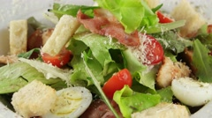 Caesar salad with chicken and quail eggs, closeup (loop) Stock Footage