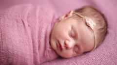 Cute newborn baby girl sleeping - stock footage
