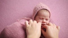 Sleeping newborn baby before photosession - stock footage