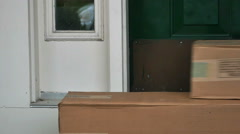 Mailman Delivered Package Boxes Sliding into the Door in Slow Motion Stock Footage