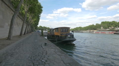 Nina tourist boat anchored in Port Debilly in Seine riverside, Paris Stock Footage