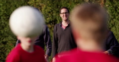 Cheerful parents watching their sons play a soccer game. Shot on RED Epic. Stock Footage