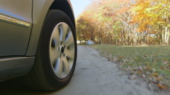 Wheel PoV Sunday drive on country road through a forest in autumn for pleasure Stock Footage