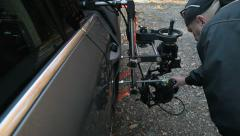 Using rig for the shots with the camera mounted on the outside of the car Stock Footage