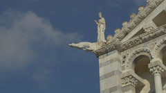Gargoyle and statue on the Cathedral of Pisa - stock footage