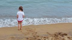 Little  Girl playing with waves at the beach Stock Footage