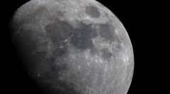 The Moon through a telescope Stock Footage