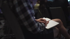 Taking notes in a meeting Stock Footage