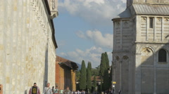 The long wall of Camposanto Monumentale and the Cathedral of Pisa - stock footage
