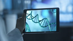 Stock Video Footage of Using Tablet with DNA Simulation. Scientific Environment.