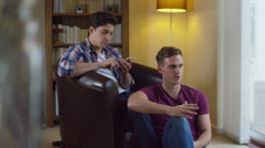 4K Attractive young gay couple having a disagreement at home.  Stock Footage