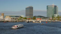 Amsterdam tour boat crosses Oosterdok Stock Footage