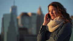 A beautiful woman talks on phone Stock Footage