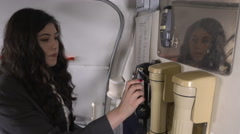Female flight attendant makes announcement to passengers Stock Footage