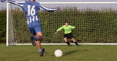 Goal keeper stopping a ball during penalty shoot. Shot on RED Epic. Stock Footage
