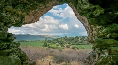 Zoom view from ruins of ancient Myus tunnel looks out to spectacular valley and Stock Footage