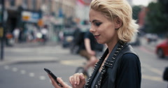 Slow Motion Portrait of happy beautiful caucasian punk woman using smart phone - stock footage
