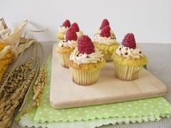 Gluten free raspberry cupcakes, corncop and rice panicle - stock photo