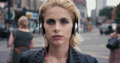 Slow Motion Portrait of  beautiful caucasian punk woman listening to music - stock footage