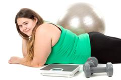Large girl with exercise ball - stock photo