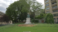 Stock Video Footage of Bronze statue of Benjamin Franklin sitting in a chair, Paris