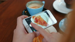 Stock Video Footage of Woman photographing her croissant on smartphone