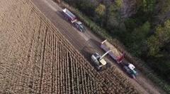 4k aerial farm tractors harvest corn Stock Footage