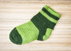 Knitted green sock, autumn fashion Stock Photos