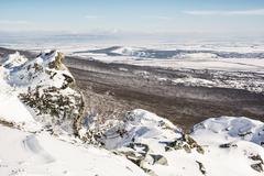 Snowy rocks, forest and fields, seasonal landscape Stock Photos