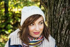 Young positive woman posing in autumn park, seasonal fashion Stock Photos