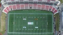 4k aerial football stadium upward pan angle directly above Stock Footage