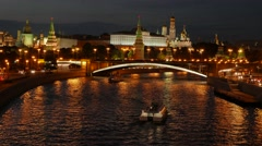 Night view of the Kremlin, Bolshoy Kamenny Bridge, Moscow River with boats and - stock footage
